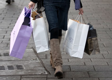 Image: A woman carries shopping bags