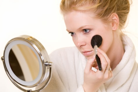 Image: Woman applies makeup