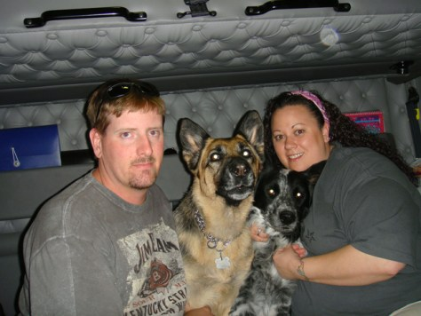 Image: Christopher and Christy Fidura with their dogs, Summer and Flash