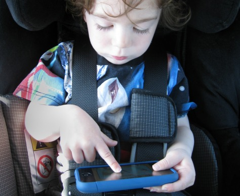 Image: 2-year-old boy with phone