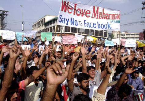 Image: Pakistani students chant slogans during a rally against Facebook page