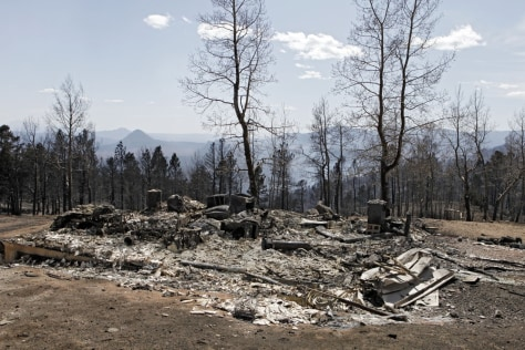 Image: The ruins of a home destroyed by a wildfire are pictured near Conifer, Colo.