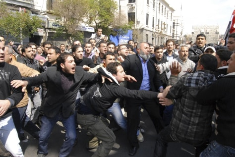 Image: Syrians anti and pro-Assad protesters clash after Friday prayers in Damascus, Syria