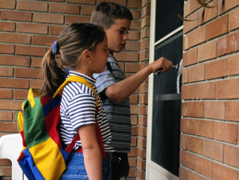 Image: Children unlocking front door