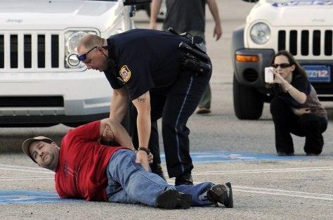 Image: Police arrest a suspect in Opelika, Ala.