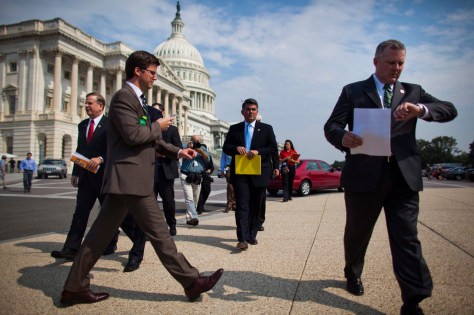 Image: Republican Representative from Arkansas Tim Griffin (R), followed by reporters and other freshman Republicans, walks to a press conference where he threw his support to Speaker Boehner's budget bill during outside the U.S. Capitol in Washington, DC