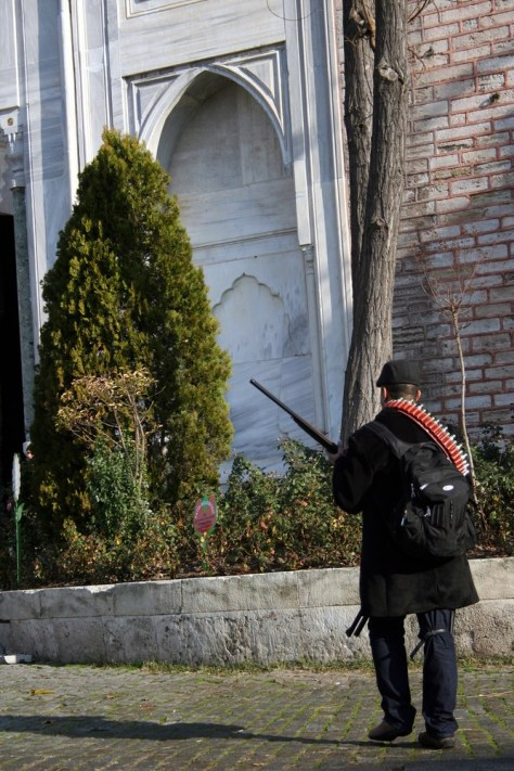 Image: A heavily armed gunman walks inside the courtyard of the Ottoman-era Topkapi Palace in Istanbul, Turkey.