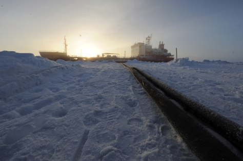Image: Two hoses used to transfer fuel from the Russian Russian-flagged tanker Renda are seen in Nome