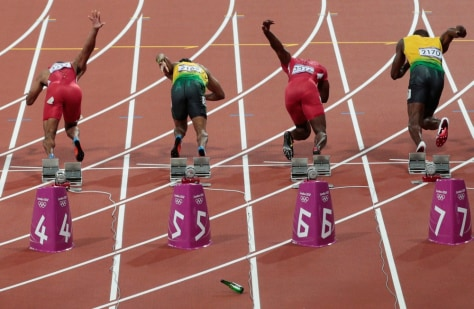 Image: Bottle lands on track at start of men's 100-meter dash
