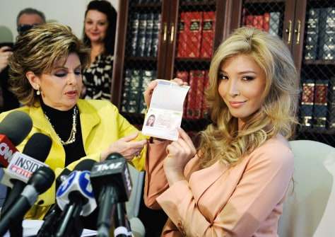 Image: Jenna Talackova (R), a would be, transgender Miss Universe contestant, shows her Canadian passport, as a proof that she is a female