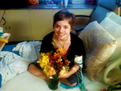 Image: Rosie Bumpus pictured in her hospital bed with her unexpected bouquet of flowers