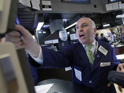 Image: Trader Gerard Petti works on the floor of the NYSE