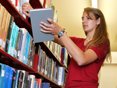 Image: Brittany Wolfe examining textbooks at a library