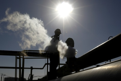 Image: Libyan oil worker, works at a refinery inside the Brega oil complex