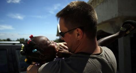 Image: Greg Keck hugs orphan