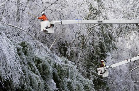 Image: Utility crews trim trees in ice storm