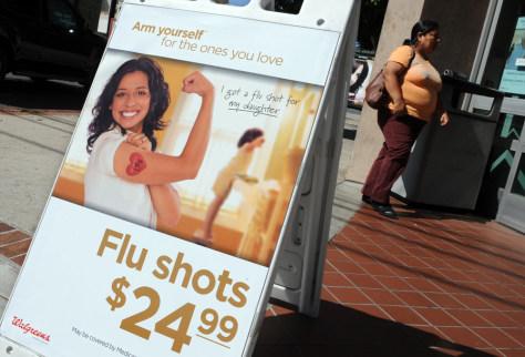 Image: A pharmacy offers flu shots
