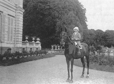 Little girl Huguette Clark on horse at chateau in France