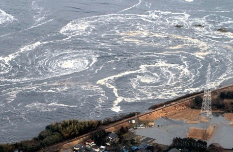 Image: Whirlpools are seen following a tsunami and earthquake in Iwaki city
