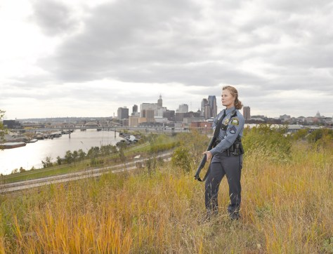 "Image: Anita, a police officer pictured with a gun in the book ""Chicks with Guns"""