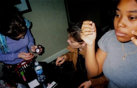 Image: Girls putting on makeup
