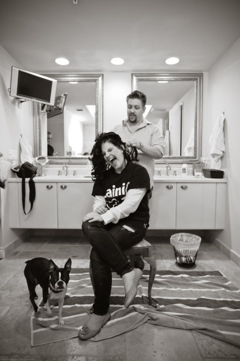 Image: Joseph Jones shaving Lainie Schultz's hair