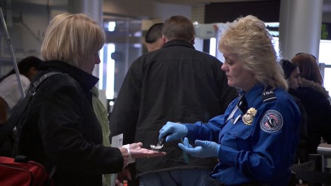 Image: A TSA officer checks a passenger for explosives in Albany, N.Y.