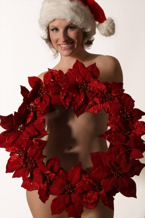Image: Boudoir photo of a woman holding a Christmas wreath