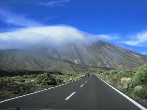 Clouds hug the peak of Mt. Teide in the Canary Islands, Spain. This is the highest elevation in Spain and an active volcano.