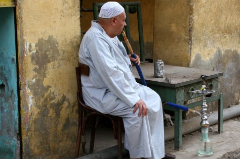Image: Man in Cairo smoking a hookah