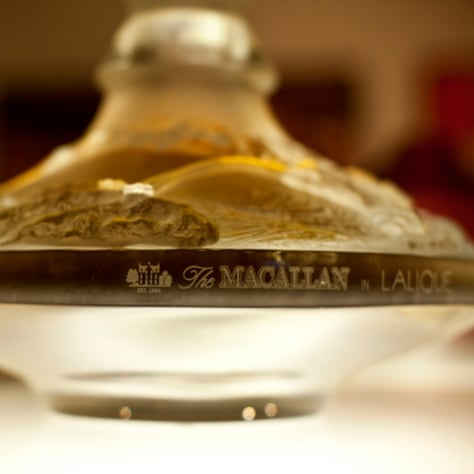 Image: 64-year-old Macallan single-malt whisky in a Lalique crystal decanter.