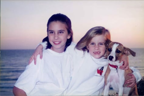Image: Two girls pose with their dog when they were younger.