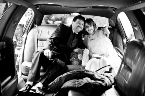 Image: Jay and Shelly Ellison in limo on wedding day