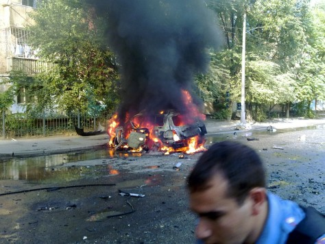 Image: A car burns in Makhachkala, the capital of Dagestan.