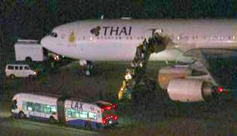 Image: Passengers leave a Thai Airlines jet at Los Angeles International Airport