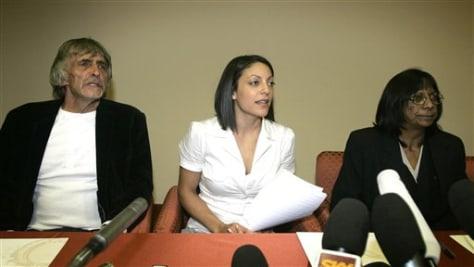Image: Stephanie Kercher, center, and parents