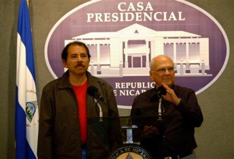 Nicaraguan President-elect Daniel Ortega and outgoing President Enrique Bolanos