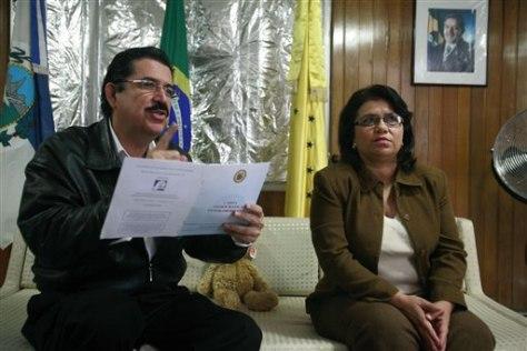 Image; Honduras' ousted President Manuel Zelaya, left, and Mayra Mejia
