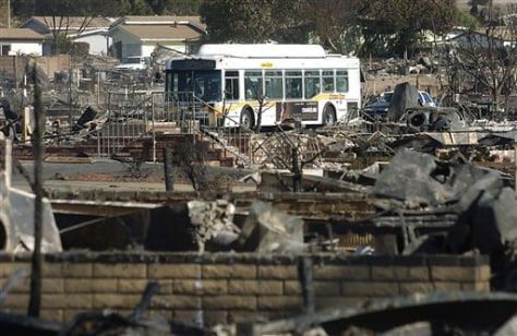 Image: Bus takes residents back into mobile home park