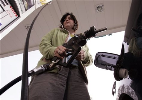 Image: Woman at gas pump