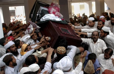 Image: Supporters reach out to touch doctor's casket.