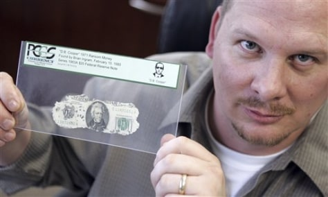 IMAGE: MAN WHO FOUND BILLS WITH ONE OF THEM