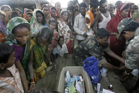 Image: Flood victims wait for medical treatment