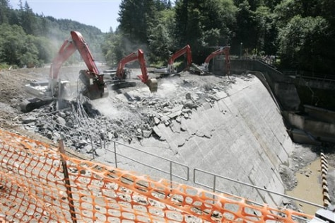 IMAGE: BACKHOES BREAK UP DAM