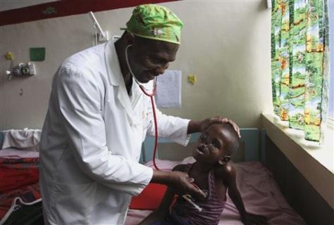 Image: Dr. Igohwo Etuh examines Ahmed Mohamed Mohamoud