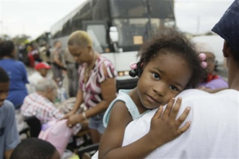 image: Child among evacuees