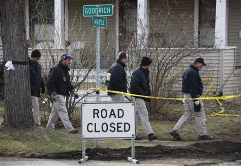Image: FBI agents search for wreckage