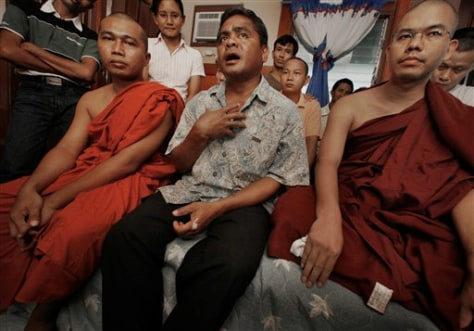Image: Myanmar Buddhist monks Agga Na Na, left, Roman Catholic priest Rusk Saburo, center, and monk Pyinna Nanda