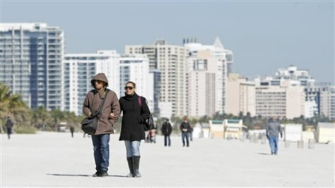 Image: Bundled up tourists in South Beach, Fla.