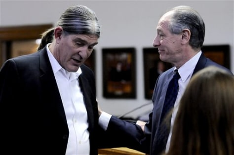 Image: Ward Churchill and his lawyer talk during closing arguments